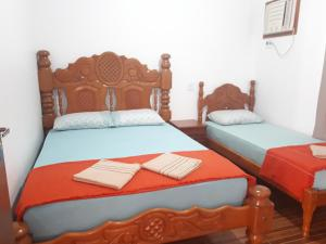 A bed or beds in a room at Flor Do Ipê Homes