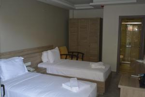 A bed or beds in a room at Seyir Village Hotel