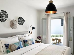 A bed or beds in a room at Santo Maris Oia Luxury Suites & Spa