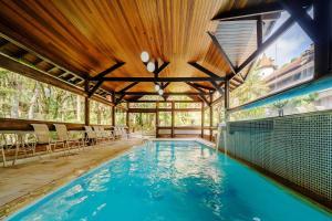 A piscina localizada em Pousada Cantos e Contos ou nos arredores