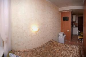 Кровать или кровати в номере Апарт-отель на Невском