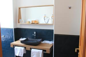 Salle de bains dans l'établissement Le Diana Hôtel & Spa NUXE