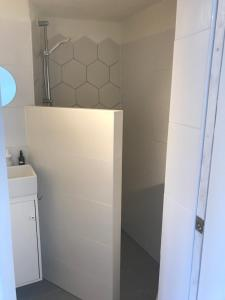 A bathroom at Cozy tiny house close to Schiphol Ams Airport