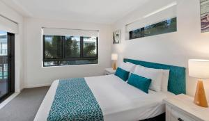 A bed or beds in a room at Sand Dunes Resort Accommodation