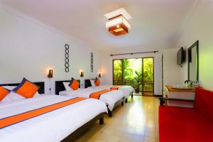 A bed or beds in a room at La Niche D'angkor Boutique Hotel