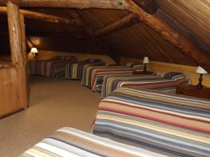 A bed or beds in a room at Arizona Mountain Inn & Cabins
