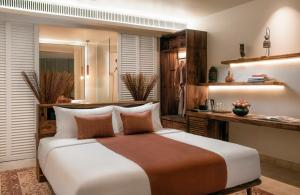 A bed or beds in a room at FCC Angkor by Avani