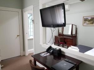 A television and/or entertainment centre at The Hughenden Boutique Hotel