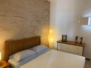 A bed or beds in a room at Eva Casa Vacanza