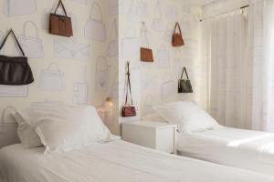 Un ou plusieurs lits dans un hébergement de l'établissement Hotel The Exchange