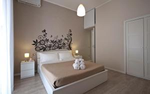 Letto o letti in una camera di Le Piazze di Napoli Apartment