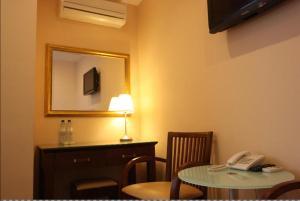 Телевизор и/или развлекательный центр в Граф Отель
