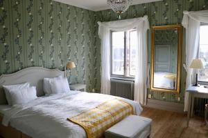 Vuode tai vuoteita majoituspaikassa Thottska Villan