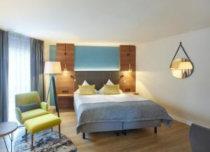 Ein Bett oder Betten in einem Zimmer der Unterkunft Aquis Grana City Hotel