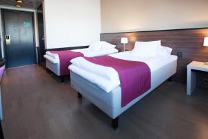Кровать или кровати в номере Hotel Oscar