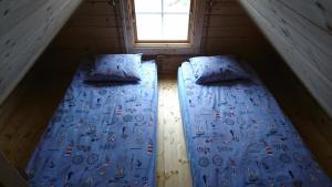 Voodi või voodid majutusasutuse Aadel Guesthouse toas