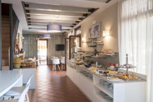 A restaurant or other place to eat at Garni Onda