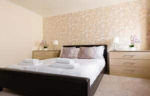 A bed or beds in a room at Canary Central