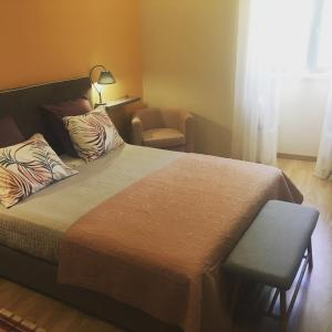 Un ou plusieurs lits dans un hébergement de l'établissement Casa da Riguerinha