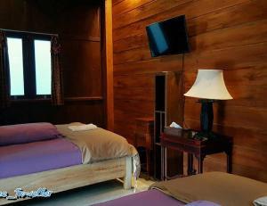 Ein Bett oder Betten in einem Zimmer der Unterkunft The Wisma
