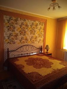 Кровать или кровати в номере Apartment in Vileyka
