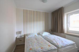 Ein Bett oder Betten in einem Zimmer der Unterkunft Ferienwohnungen Reimann