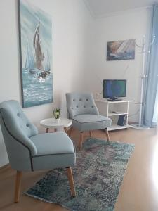A seating area at Apartments & Rooms Vitt