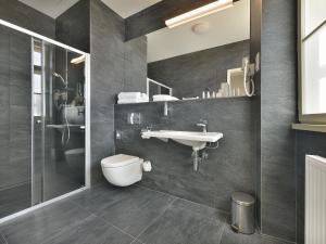 A bathroom at EA Hotel New Town