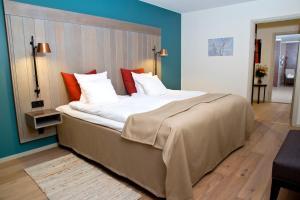 Säng eller sängar i ett rum på First Hotel Grand Falun