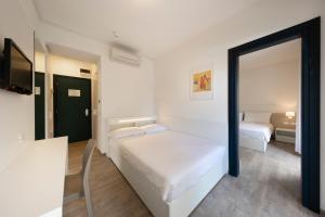 Postel nebo postele na pokoji v ubytování Hotel Delle Nazioni