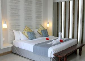 A bed or beds in a room at Anelia Resort & Spa