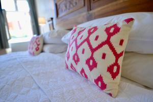 Cama ou camas em um quarto em Casa Augustus