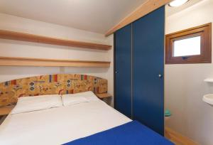 A bed or beds in a room at Camping Village Poljana
