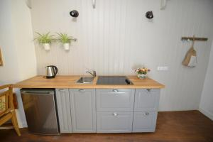 A cozinha ou cozinha compacta de Casa Augustus