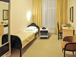 A bed or beds in a room at Intourist Hotel