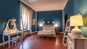 Cama o camas de una habitación en Le Fate Holiday Homes