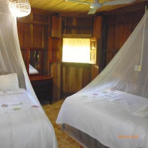 A bed or beds in a room at Hotel Nueva Alianza