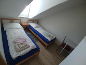 A bed or beds in a room at KV APARTMANS Varšavská