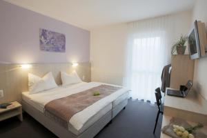Ein Bett oder Betten in einem Zimmer der Unterkunft Topmotel