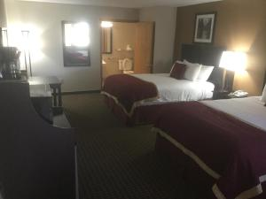 A bed or beds in a room at Baymont by Wyndham Cortez