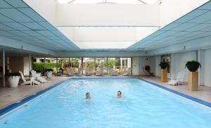 The swimming pool at or near Amrâth Hotel Brabant