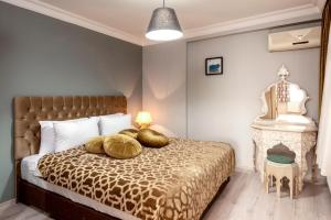 A bed or beds in a room at Masal Apart