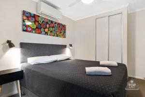 A bed or beds in a room at Jurien Bay Tourist Park