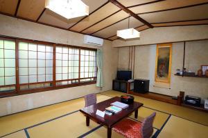 A seating area at Hinode Ryokan