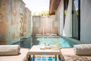 The swimming pool at or close to Robinson Club Khao Lak