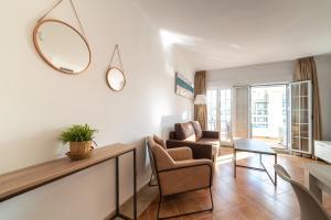 Zona de estar de Apartamentos Costaluz Las Dunas