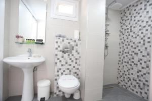 Ванная комната в Sun Hotel
