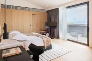 A bed or beds in a room at briig boutique hotel