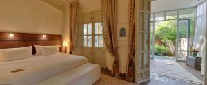 Un ou plusieurs lits dans un hébergement de l'établissement Dar Rhizlane, Palais Table d'hôtes & SPA