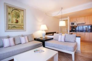 A seating area at Grupotel Macarella Suites & Spa